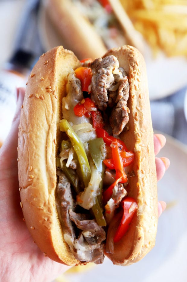 Hand holding Instant Pot philly cheesesteaks image