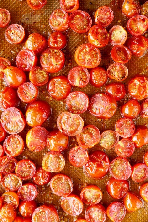 roasted cherry tomatoes on baking sheet image
