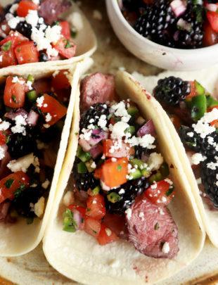 Steak tacos on platter with blackberry salsa image