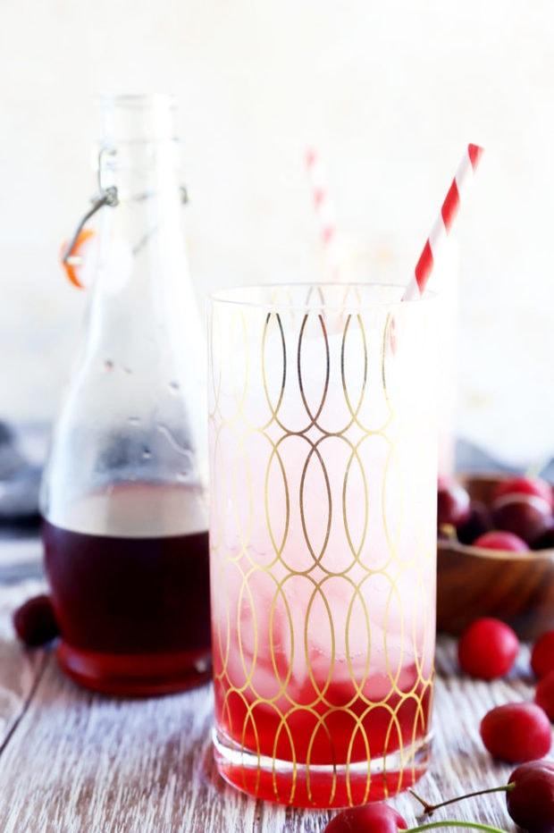 Cherry soda in a glass with straw image