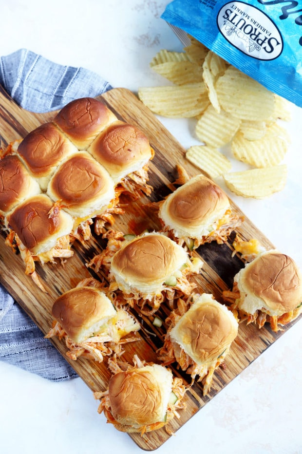 Sliders on a board with potato chips image