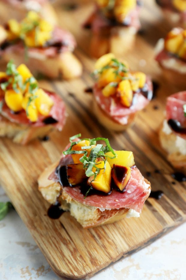 Salami peach ricotta crostini on platter image