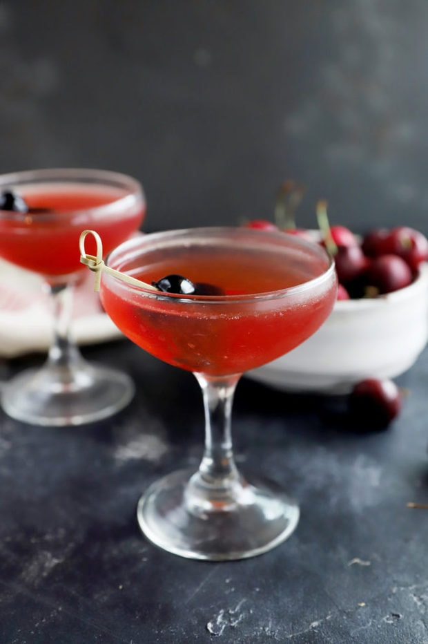 Photo of cherry cocktail in coupe glasses