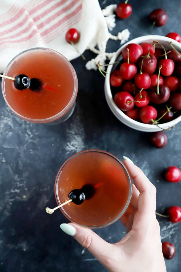 Hand holding cherry cocktail image