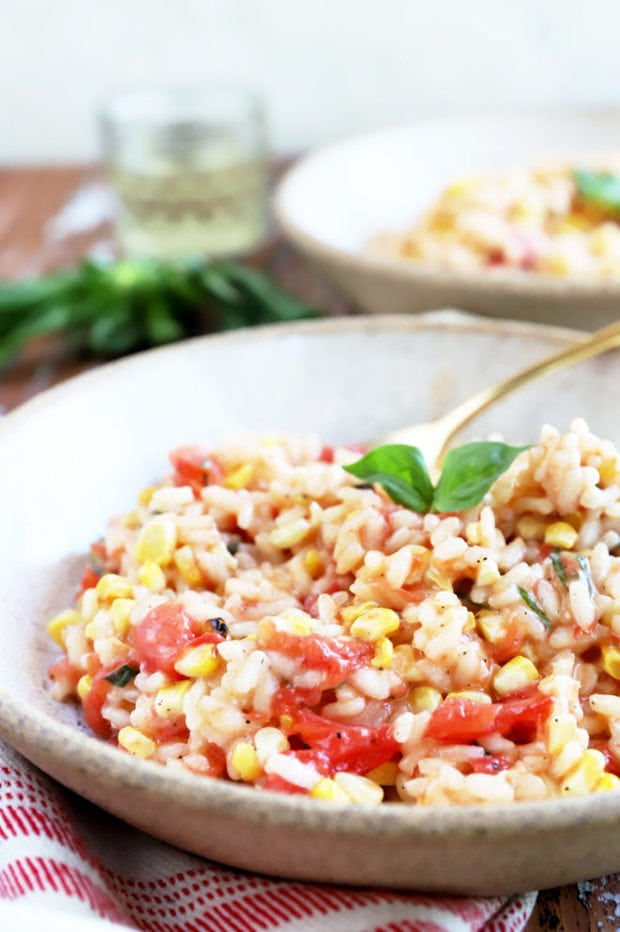 Side photo of tomatoes and corn in risotto