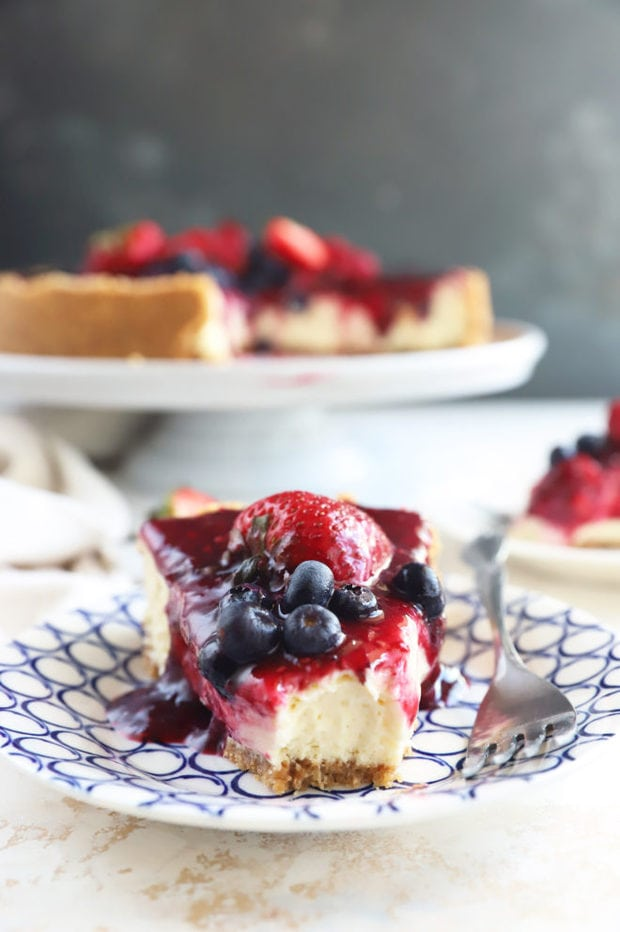 Slice of triple berry cheesecake image