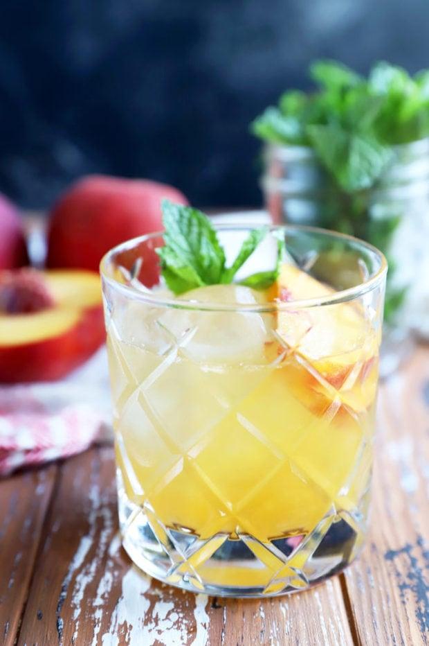 Side photo of bourbon peach smash cocktail