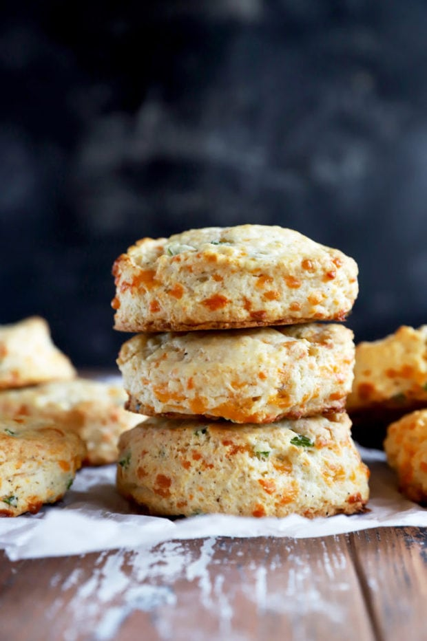 Side photo of a stack of cheddar biscuits