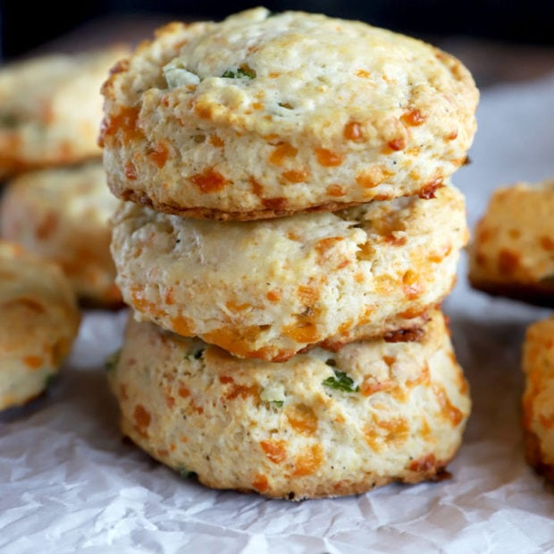 Side photo of a stack of jalapeno cheddar biscuits